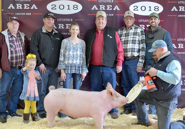 A group of people with a prize-winning pig
