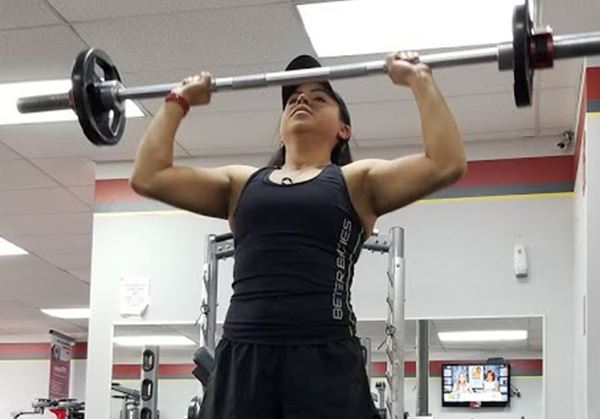 A woman lifts weights
