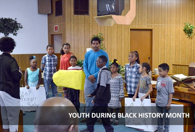 Young people attend an event during Black History Month