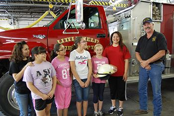 Children stand in front of a Littlefield Fire vehicle